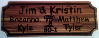 chipped wooden sign with palm tree