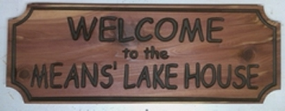 Chipped wooden lake house sign