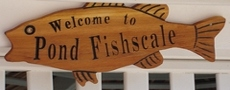 Bass shaped cedar wooden sign