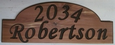 Topper styled wooden sign for a mailbox mounted address plaque