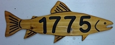 Trout shaped wooden sign for use as an address plaque
